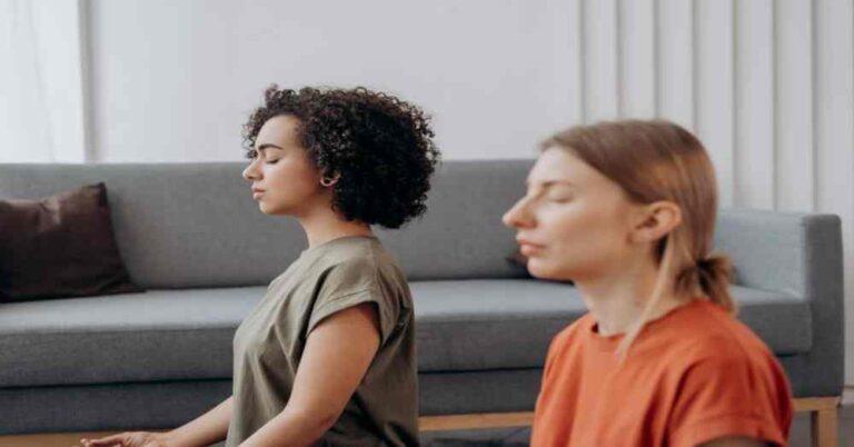 Two woman sitting and doing Vipassana meditation